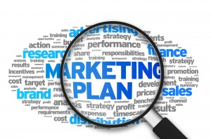 Magnified illustration with the words Marketing Plan on white background.